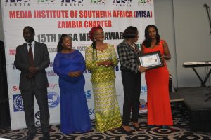 PSAf Executive Director Ms. Lilian Saka-Kiefer presenting an award to Pennipher Nyirenda from the Zambia National Broadcasting Corporation during the 2017 MISA Media Awards in Lusaka